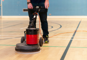 cleaning a sports hall with a floor cleaning machine